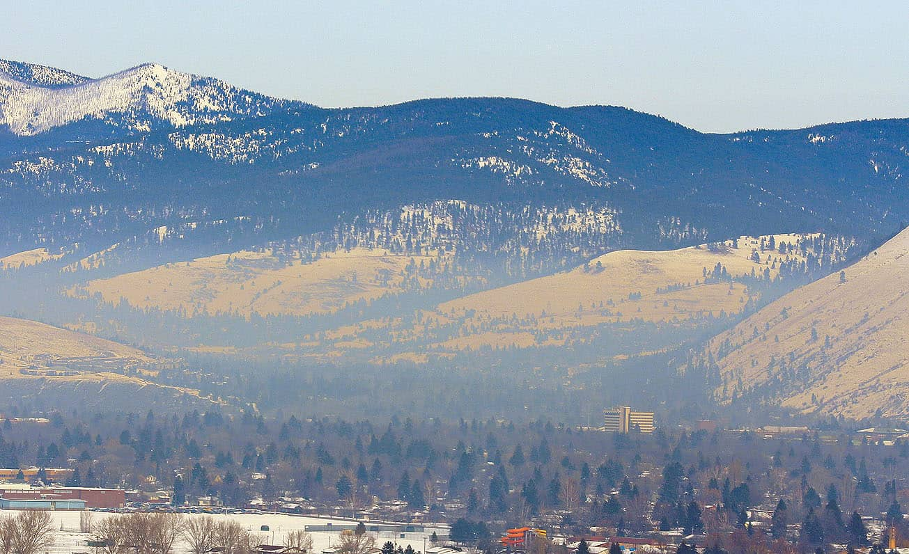 Breath Deeply? The Missoula Valley has some of the worst air quality in the country.  Pictured here is a view of the University and downtown area from a Stage 2 air pollution warning day in January 2013. Photo by Chad Harder.